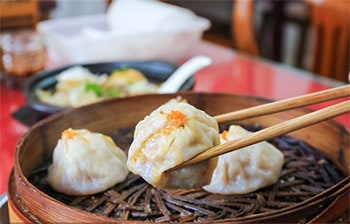 Shanghai Night Food Tour with Huangpu River Cruise